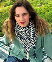 Model wearing Not Really Stormy scarf in cream and navy blue