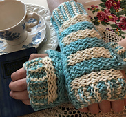 Tigger Mitts have broad horizontal stripes on top, bordered by ribbed cuffs at the wrist and fingers in smaller vertical stripes. The reverse is a solid color in 3 by 2 ribbing.