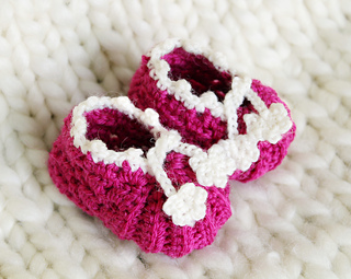 Baby booties with flower trim