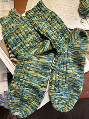 The knitting is done but the socks still need to be washed.