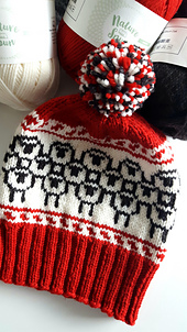 red, white & black hat with stranded sheep motif