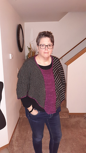 """Model is 5'-9"""" with 46"""" bust wearing Size 2 that is knit slightly smaller than pattern gauge. This creates a more cropped fit overall."""