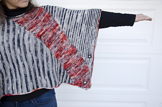 This styling shows the piece squarely on the shoulders with the stripes in the vertical direction. 2 pedestal-style removable button closures create a more closed sleeve.