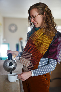 Rachel wearing gradient wrap, pouring tea