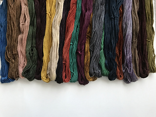 Yarns from Six and Seven Fiber in color blocked color scheme