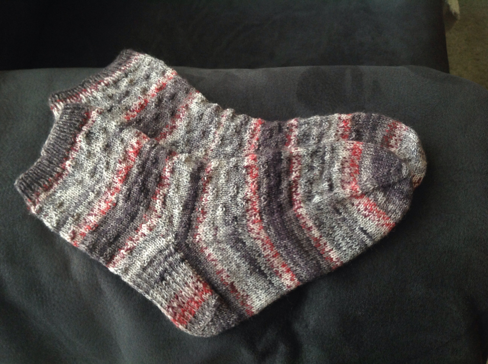 The first pair of socks I ever finished: self-striping and too big
