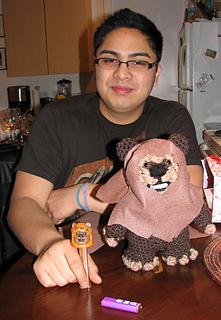 kyle with his ewok pez and amigurumi ewok