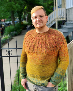 """Size 46"""" shown on a 44"""" model. Knit with a variety of stash yarn, *see knitter's project page for info"""