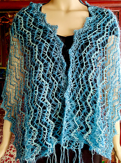 Can't decide whether to weave in all the ends or to add tassels/fringe.