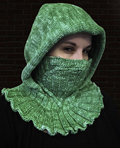 A cabled cowl combined with a warm hood makes for roguish style and extra coziness!