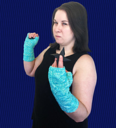 Warm cabled armwarmers with lightning-like cables on one side and Zen-like twisted stitches on the other.